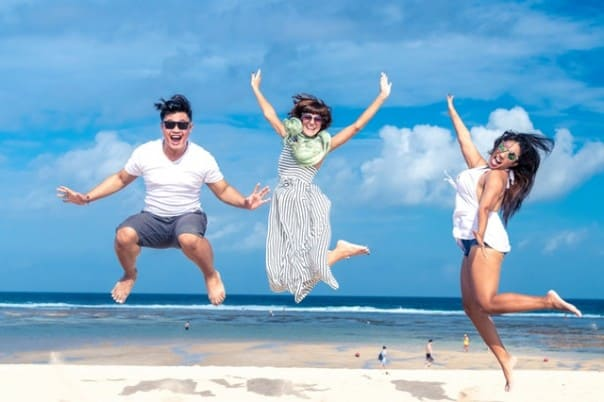 people enjoying a vacation: save money for a vacation today