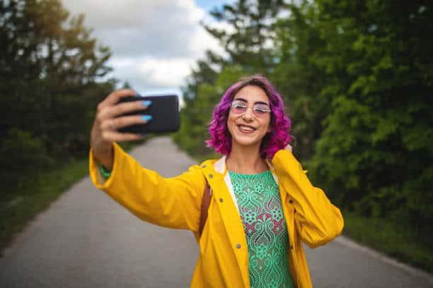 Travel social media influencer on her phone
